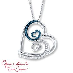 From the Open Hearts Waves by Jane Seymour™ collection, this necklace features lovely round blue and white diamonds along two waves that crash together to form the iconic Open Hearts by Jane Seymour® design. Styled in sterling silver, the pendant has a total diamond weight of 1/20 carat and is suspended from an 18-inch box chain that fastens with a lobster clasp. Blue diamonds are treated to permanently create the intense blue color. Diamond Total Carat Weight may range from .04 - .06…