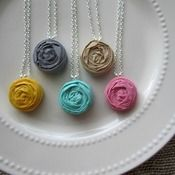 Love these single rosette necklaces