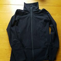 Black lululemon jacket Black zip up lululemon jacket. Front pockets, thumb holes. Zips all the way up the neck. Super warm and cute. Size 6. Gently worn, in excellent condition. Selling it cheaper on Merc lululemon athletica Jackets & Coats