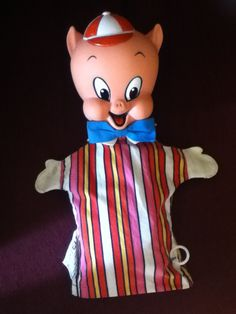 "1965-Porky Pig Puppet- is about 13"" tall and made of striped material and wears a blue bow-tie."