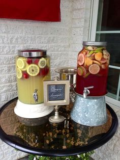 Drinks looking pretty at a graduation party I catered.  Great job Heather!  Family room bar. One with water. One with lemonade. One outside at bar with sangria.