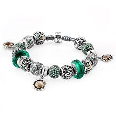Pandora Enchanted Forest Bracelet The Pandora Enchanted Forest Bracelet features a combination of rich brown gems & green CZs and murano glass, paired with owl, tree and leaf charms. This bracelet makes a great fall statement.