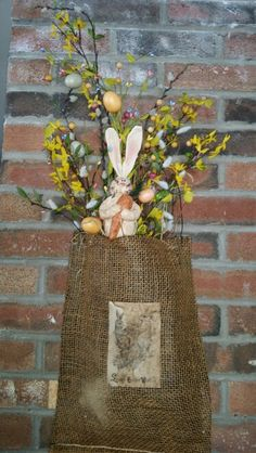 Burlap hanging sack with pip berries,  flowers and bunny pick