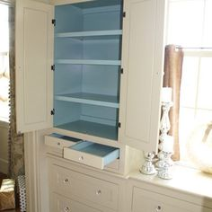 like this.  the little drawers and the bigger upper cabinets, not with shelves...spacing for long pants and dresses