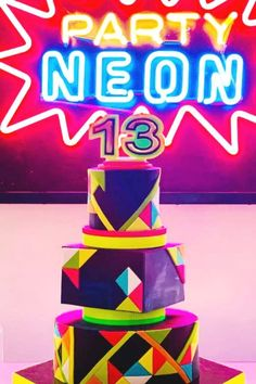 Don't miss this colorful neon birthday party! The cake is amazing! See more party ideas and share yours at CatchMyParty.com   #catchmyparty #partyideas #neon #neonparty