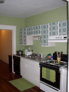 Fantastically simple way to cover ugly cabinet.