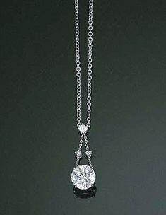A DIAMOND PENDANT NECKLACE The circular-cut diamond weighing 2.08 carats…