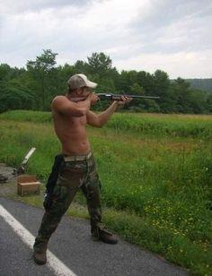 nothing more sexier than a hot, shirtless guy shooting a gun