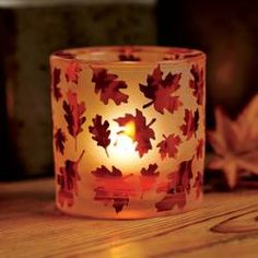 """Autumn Glow Votive Holder - A warm fiery glow is just right for the season. A votive or tealight, sold separately, flickers through an orange leaf motif for a brilliant fall display. Acid etched glass with sprayed color finish. 3""""h, 2""""dia. Price:  $15.00 each"""
