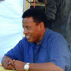 Wayne Shorter, the incomparable jazz composer and saxophonist, signs autographs at the 2000 Monterey Jazz Festival.     (Photo © TA Thompson)