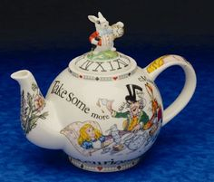 Alice in Wonderland Mad Hatter Tea Pot - We've got a GIANT cup with this design on................which is superglued together after the farm cat knocked it off a shelf!! Still looks great ;D