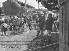 1920's. A rare view of firemen drilling with mechanized pumps at what appears to be a factory.