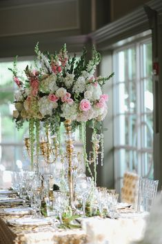 tall centerpiece, photo by Richard Israel http://ruffledblog.com/charlotte-botanical-gardens-wedding #weddingflowers #weddingcenterpieces