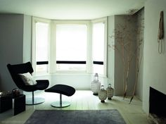 Striking black and white roller blinds in a bay window