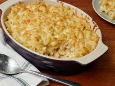 Macaroni and Cheddar Cheese : Nutmeg and cayenne are the secret ingredients to Rachael's decadent macaroni and cheese. Top the casserole dish with more cheese, and bake until bubbling and slightly browned.