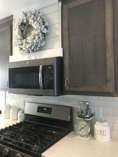Shiplap hood vent, modern farmhouse, gray kitchen, rae dunn, flocked wreath, subway tile, Ge slate