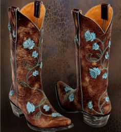 Fav so far! Distressed brown leather western boots with blue floral stitching
