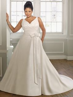 Strapless gowns are lovely but can be difficult to wear. I love a gown with straps or some other type of upper body support. This is gorgeous!
