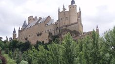 Places to see in ( Segovia - Spain ) Alcazar de Segovia  The Alcázar of Segovia is a castle located in the old city of Segovia Spain. Rising out on a rocky crag above the confluence of two rivers near the Guadarrama mountains Alcazar de Segovia is one of the most distinctive castle-palaces in Spain by virtue of its shape  like the bow of a ship. Alcazar de Segovia was originally built as a fortress but has served as a royal palace a state prison a Royal Artillery College and a military…