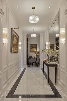 hallway flooring The main entrance hall has extravagant marble flooring and panelled walls with a library area at one end and an elegant power room skillfully hidden behind paneling off the hallway Design Living Room, Home Room Design, Home Interior Design, House Design, Neoclassical Interior Design, Living Rooms, Flur Design, Hall Design, Entrance Hall Decor