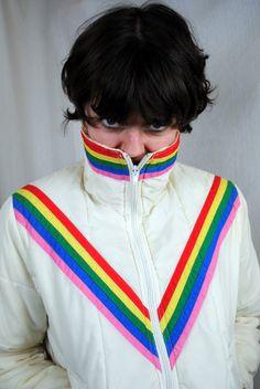 Awesome 1970s 1980s Vintage Puffy Ski Striped Rainbow Jacket Coat. $35.00, via Etsy.