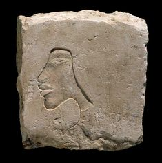 Akhenaten shown on a sculptor's trial piece from the Central City. Photo: G. Owen.