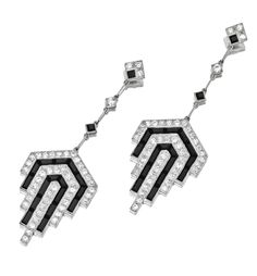 PAIR OF ONYX AND DIAMOND PENDANT-EARRINGS.  The pendants formed of plaques of geometric design set with alternating bands of old European-cut diamonds and calibré-cut onyxes, supported on fringes of onyx and diamond links, the total diamond weight approximately 3.20 carats, mounted in platinum. Art Deco or Art Deco style.