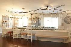 Christmas decor...hang branches and ornaments with fishing line! So pretty!
