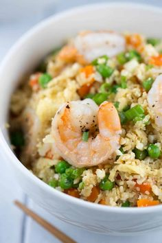 Shrimp placed on top of a bowl of fried rice