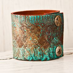 Turquoise Jewelry Cuff Bracelet  (Website doesn't state what it's made of. Maybe Leather, Metal Or Polymer Clay?)