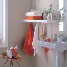 Shelf with hooks underneath.  Small Bathroom Storage Ideas