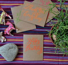 enjoying the neon on paperbag look--I would like to try something similar. banquet stationery