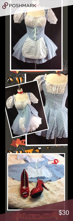 """Dorothy Halloween Costume Wizard of Oz Sexy Dress Cute gingham plaid costume. Has zip up back and elasticize neck line. Can be worn on and off shoulders. Approx measurements are chest- 16"""" Stretched 18"""""""" Bust 32""""-36"""" full C cup. Waist- 14"""" stretched 16"""". Length- 23.5"""". 100% poly.  Approx measurement for Large is chest- 17""""stretched 19"""". Waist-16"""" stretched 18"""". Length 23.5"""". Petticoat tutu not include but is for sale in my closet. Sequin shoes are also for sale in my closet.   Leg Avenue…"""