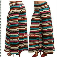 "Palazzo pants trousers high waist fold over new New sexy chic boho palazzo trouser pants. Abstract print. Vibrant colors.  Trendy High waist  Wear waistband folded down or leave up for high waist. Wide flared leg. Bell bottom.. Foldover  Made out of stretchy fabric.  Material:	92% POLYESTER 8% SPANDEX knit fabric. Medium weight.  Measurements Inseam: 30"" #bohemian #boho #chic #sassy #palazzostyle #palzzopants #vibran#abstracpattern #abstractprint Boutique  Pants Wide Leg"