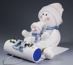 DIY sock snowmen on a sled