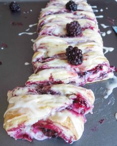 Vanilla Glazed Blackberry Danish Braid. Juicy, homemade blackberry preserves over a bed of sweet cream cheese, all wrapped up in a buttery, flakey dough. Absolutely amazing for breakfast or as a dessert!