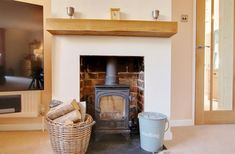 Wood burning stove at this North Boarhunt, 3 Bedroom Property - towel rail Towel Rail, Wellness Design, Integrated Appliances, Shower Cubicles, Timber Gates, Oak Mantle, Loft Spaces, Property, Wood Burning Stove