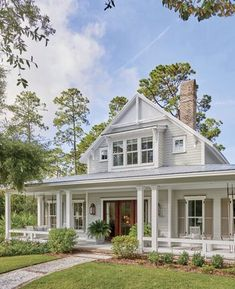 We're Loving This Lowcountry Farmhouse House Plan is part of House plans farmhouse - Classic Southern architecture, breezy colors, and a dose of cozy textures create a new home with a comfortably old feeling Southern Farmhouse, Southern House Plans, Southern Homes, Farmhouse Design, Rustic Farmhouse, Farmhouse Front, Farmhouse Home Plans, Southern Charm, Farmhouse Style Homes
