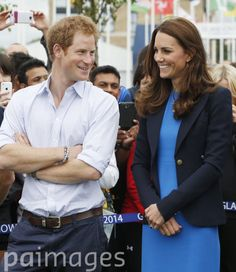 The Duchess of Cambridge and Prince Harry during a visit to the Commonwealth Games Village in Glasgow.