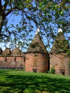 Oast Houses, Sissinghurst Castle, Kent, UK - An oast, oast house or hop kiln is a building designed for kilning (drying) hops as part of the brewing process.