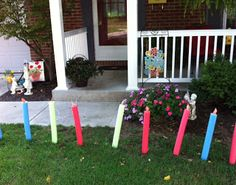 Make these DIY candles to put out in the birthday girl/guys yard.  Made out of swim noodles.