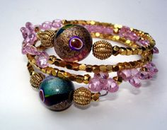 memory wire bracelet with enough small beads to carry the few big ones