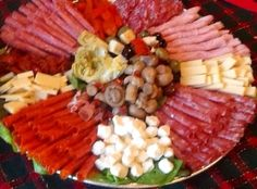 I learned to make this through my husband's aunt whom is Italian. It's an Italian tradition. This platter is a delicious way to set the stage for the holiday dinner to be served
