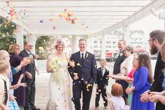 Christmas holiday themed wedding at Disney's Boardwalk and Sea Breeze point by Orlando wedding photographer