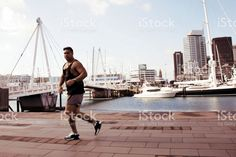 Pacific Island Man Runs against a Cityscape Harbour royalty-free stock photo Lifestyle Photography, Fine Art Photography, Interracial Marriage, Island Man, Kiwiana, Image Now, Royalty Free Stock Photos, Artistic Photography, Art Photography