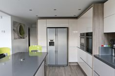High gloss handleless kitchen units in cashmere and cream showing american style fridge, grey quartz / silestone worktop, vintage ash wood effect porcelain tiles on the floor. Grey Kitchen Diner, Cream Kitchen Units, Cream And Grey Kitchen, Grey Gloss Kitchen, Kitchen Living, Ash Wood Floor, Wood Effect Floor Tiles, Handleless Kitchen, Kitchen Worktop