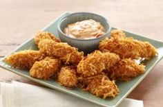 Pair a mayo and mango chutney with these Coconut-Chicken Dippers. Our Coconut-Chicken Dippers are the perfect casual finger food for game day or any day. Chicken Dippers, Oven Baked Chicken, Chicken Bites, Chicken Tenders, Baked Coconut Shrimp, Coconut Chicken, Kraft Recipes, Kraft Foods, Cooking Chicken To Shred