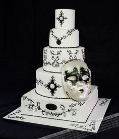 Black and white venetian mask cake by Design Cakes, via Flickr
