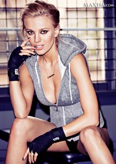 Bar Paly in a sexy sports outfit in a gym