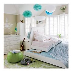 Love the Pom Pom and the rug. Rug like that in green or orange would work in girls room or nursery